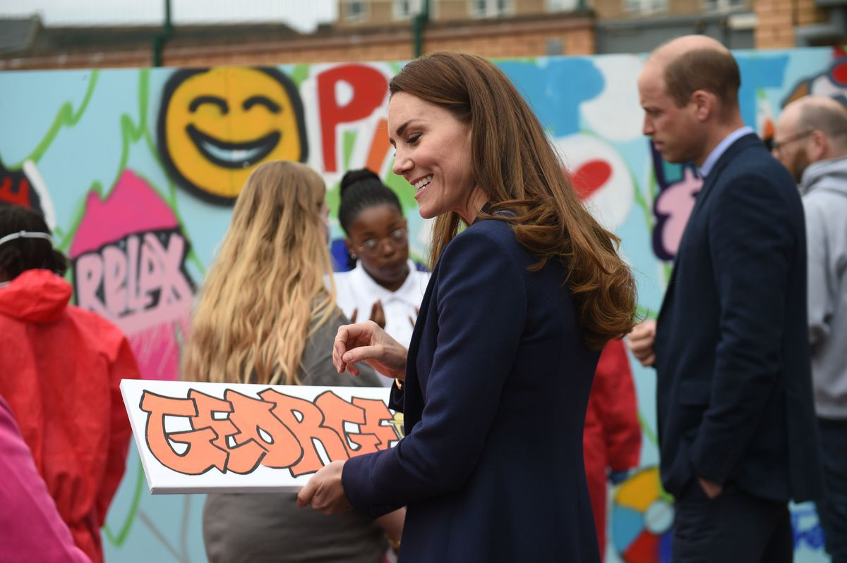 The Duchess of Cambridge is presented with a gift for Prince George