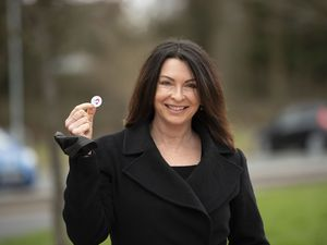 The broadcaster with her 'I've had my Covid vaccination' badge after having the virus jab at Aldersley Leisure Village