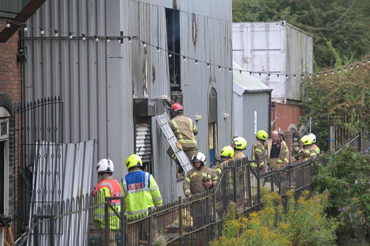Officers were seen cutting into the side of the building to make accessing the blaze easier. Photo credit: WMFS