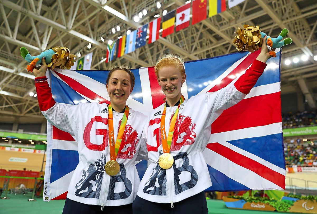 Helen Scott and Sophie Thornhill on the podium after winning gold at the 2016 Rio Paralympic Games
