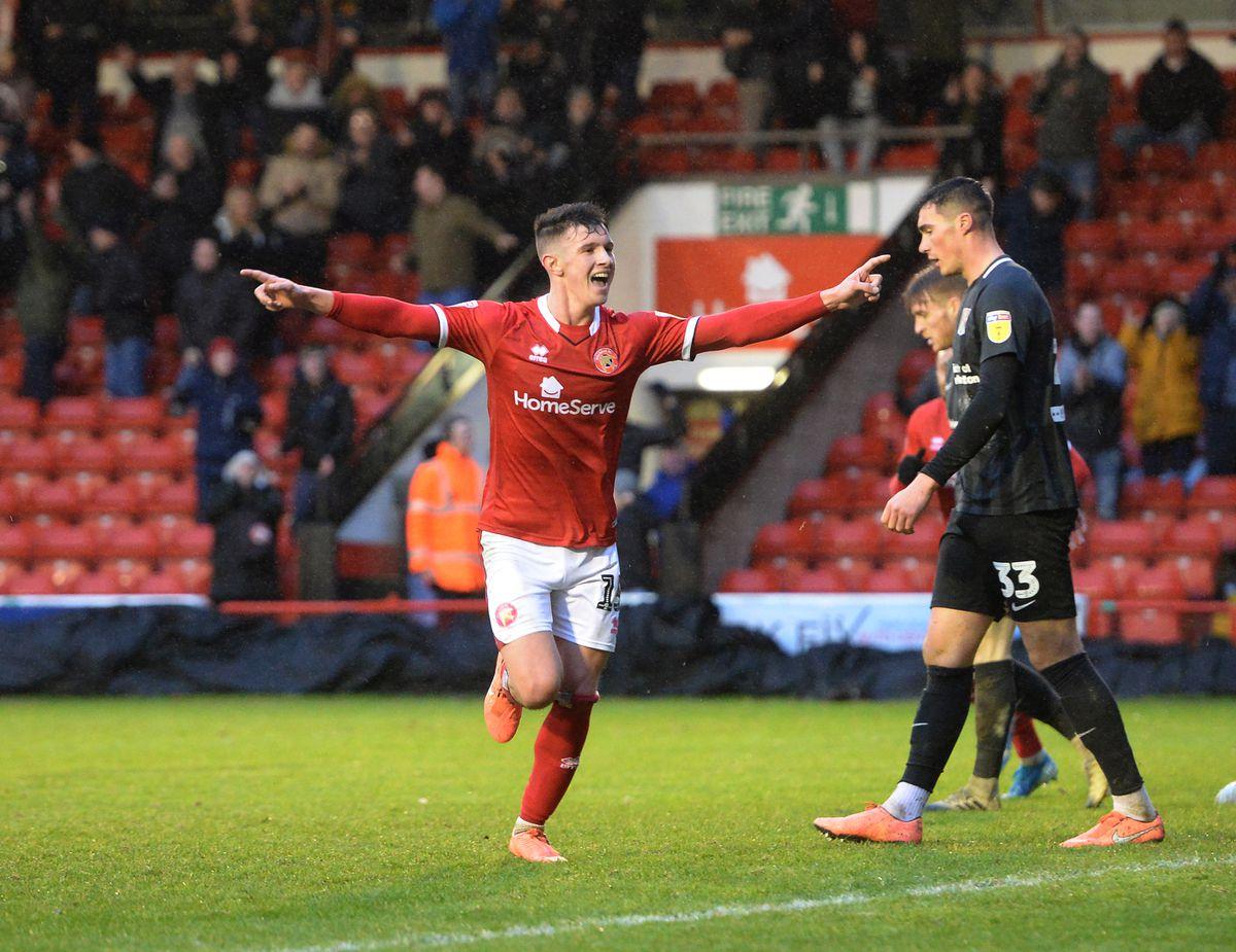 Rory Holden celebrates his last minute winner against Northampton