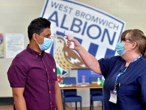 SANDWELL COPYRIGHT EXPRESS AND STAR STEVE LEATH 07/07/2021..Pics at The Hawthorns, West Bromwich Albion, where the Covid Vaccine Team were at work.   Shahed Ahmad from Smethwick, temperature checked by: Helen Weaver.