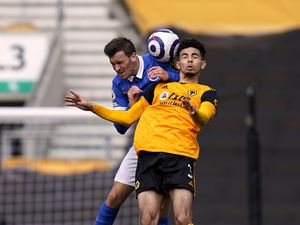 """Wolverhampton Wanderers' Rayan Ait-Nouri (right) and Brighton and Hove Albion's Pascal Gross battle for the ball in the air during the Premier League match at Molineux Stadium, Wolverhampton. Picture date: Sunday May 9, 2021. PA Photo. See PA story SOCCER Wolves. Photo credit should read: Tim Keeton/PA Wire.   RESTRICTIONS: EDITORIAL USE ONLY No use with  unauthorised audio, video, data, fixture lists, club/league logos or """"live"""" services. Online in-match use limited to 120 images, no video emulation. No use in betting, games or single club/league/player publications."""