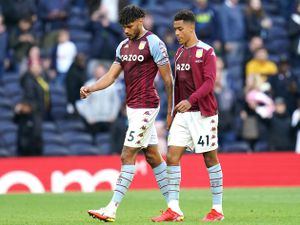 Aston Villa's Tyrone Mings (left) and Jacob Ramsey look dejected after the final