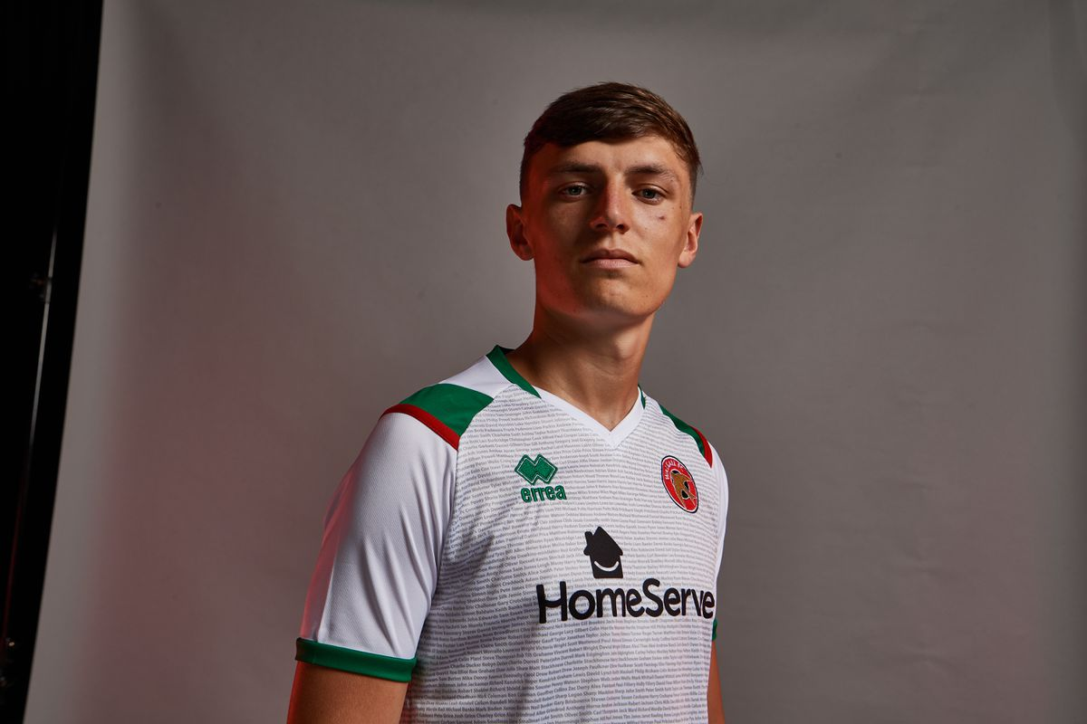 Sam Perry models the new third kit