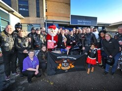 Roaring success: Bike group donates presents to children in hospital over Christmas