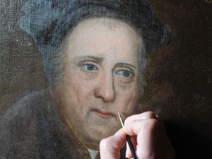 Detail image of the Rowland Hill oil painting being restored