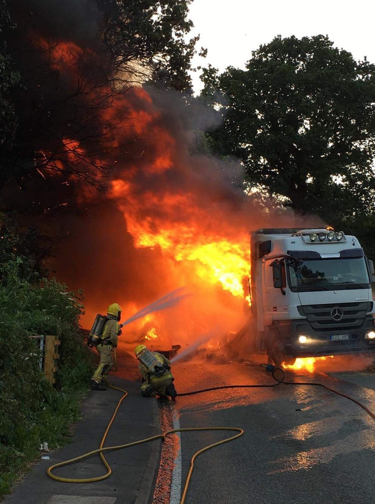 Flames burst from the lorry