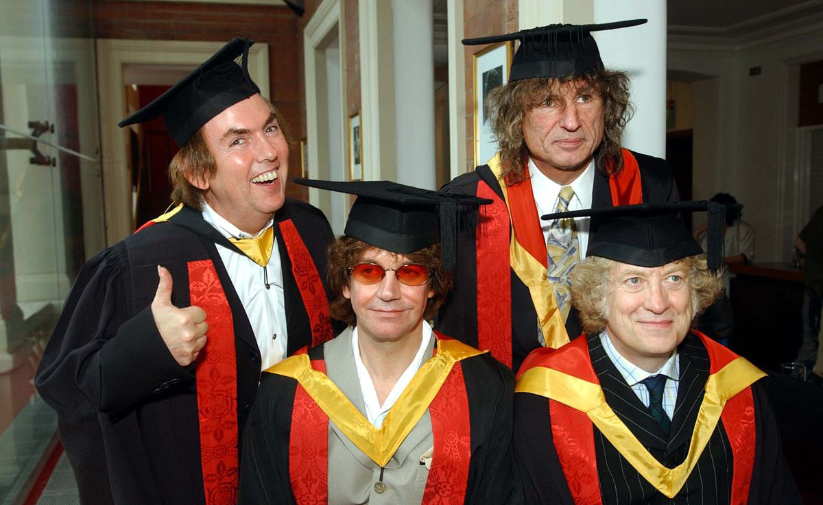 Dave Hill, Jim Lea, Don Powell and Noddy Holder collect their honorary followships from the University of Wolverhampton in 2002