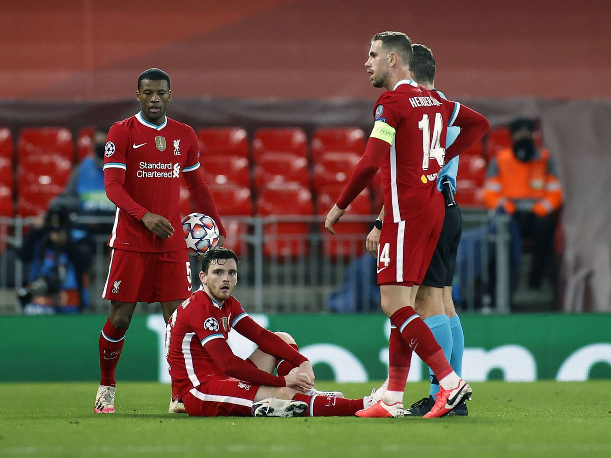 Liverpool's Andrew Robertson waits for the physio