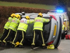Woman trapped as car overturns near Wolverhampton