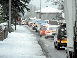 Icy roads lead to dozens of crashes and bus diversions