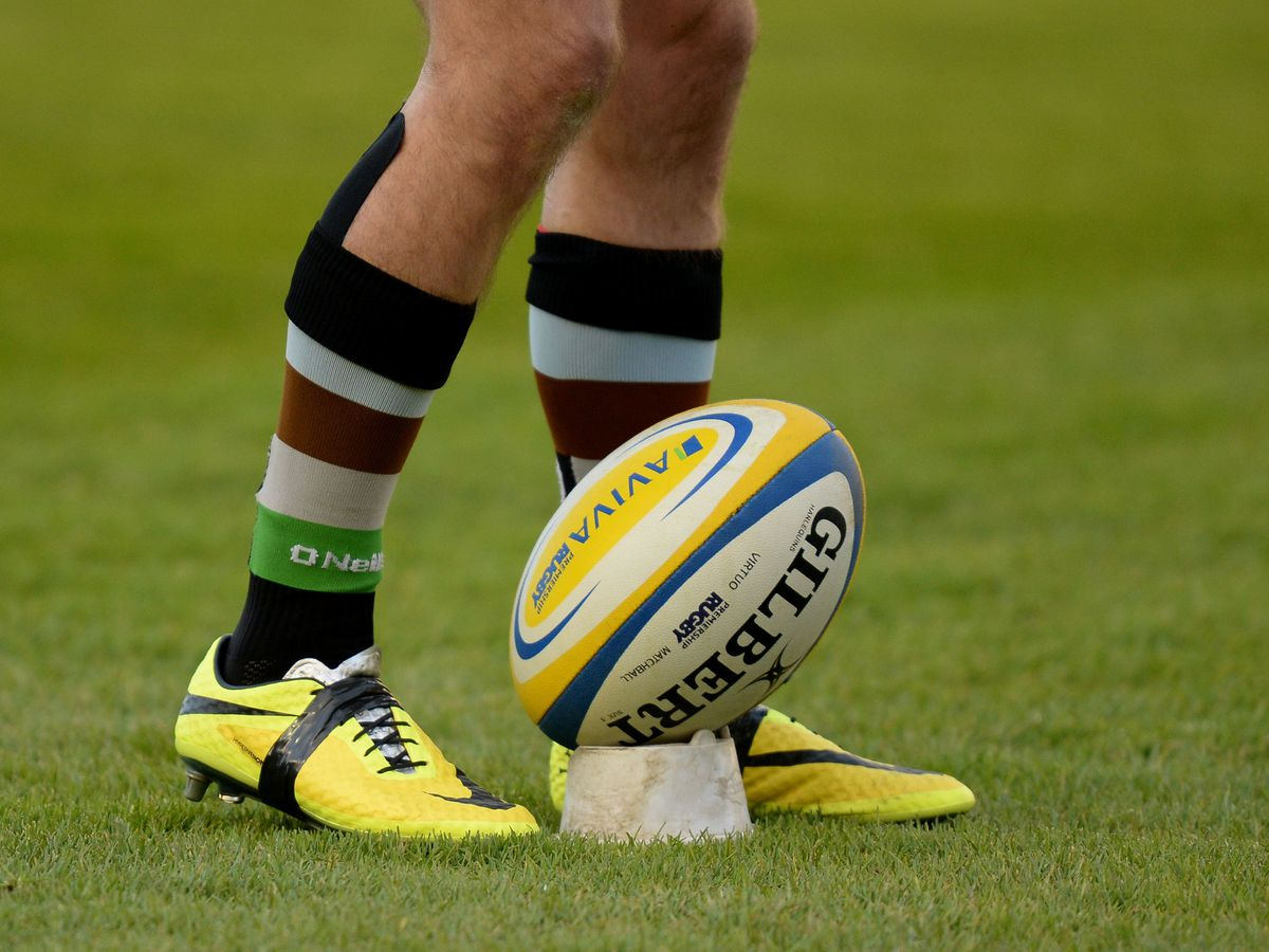 A rugby ball on a tee