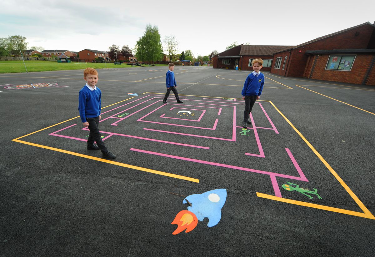 WOLVERHAMPTON PIC/ DAVID HAMILTON PIC / EXPRESS AND STAR PIC 13/5/21 In the new playground, pupils (left-right) Lucas Doran, aged 8, Ethan Owen, aged 7, and Ned Kennerley, aged 8, at Perton Primary Academy, Perton, Wolverhampton..