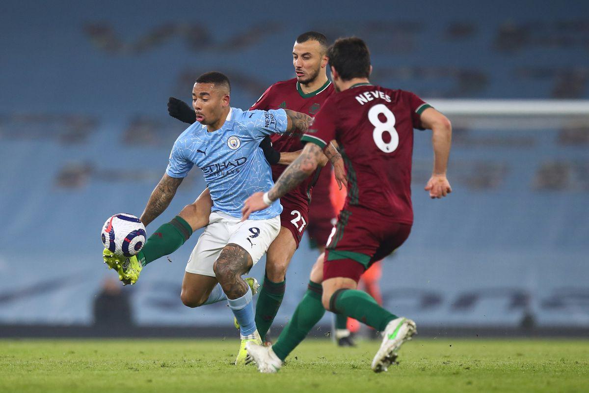 Gabriel Jesus of Manchester City and Romain Saiss of Wolverhampton Wanderers (AMA)