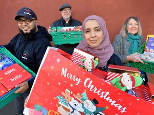 WALSALL COPYRIGHT TIM STURGESS EXPRESS AND STAR...... 26/11/2020.  Volunteers at Walsall Outreach with boxes of food and other Christmas items to promote its Covid Christmas appeal. Pictured left, Ali Khan,Steve Hinks,Shazia Nasrren and Andrea Stanton.  .