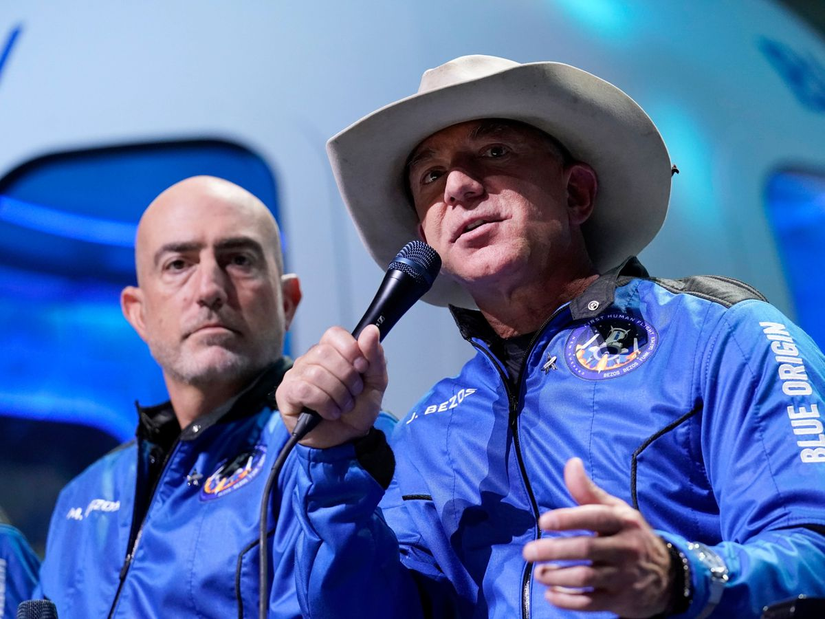 Jeff Bezos and brother Mark at a news conference after their Blue Origin space flight