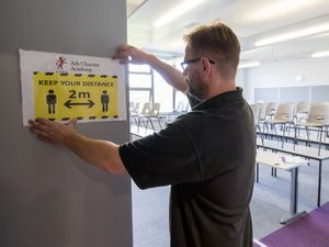A social distancing sign is put up in a classroom at Ark Charter Academy in Portsmouth