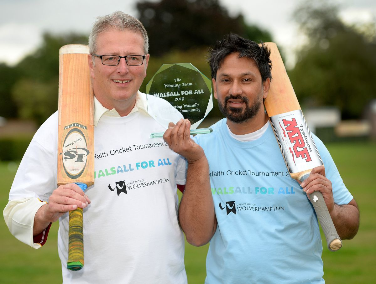 Captains Pete Connolly, WLV Sport Commercial Manager, and Imran Suddle, programme manager of Walsall for All, pose with the trophy