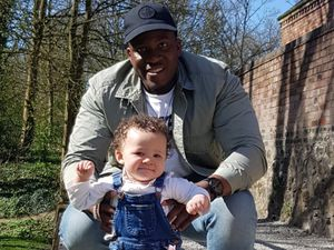 Nathan Burton with his daughter. Photo: West Midlands Police