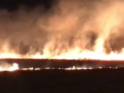 Fire sweeps across farm land sending flames into night sky near A449 - WATCH