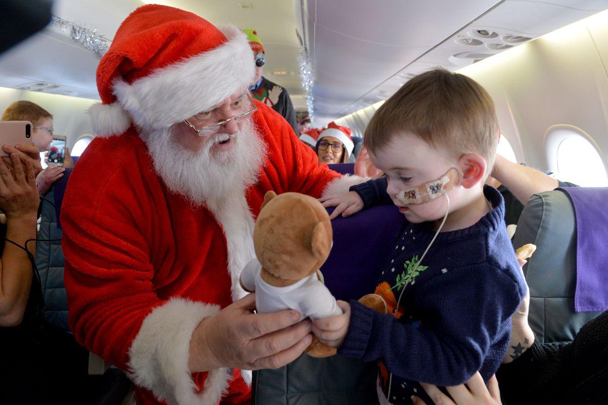Alfie Gray-Lancaster gets a present from Santa