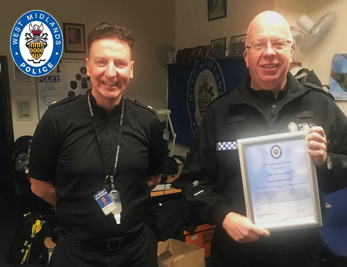 Superintendent Philip Asquith presents Michael with the Good Citizen Award