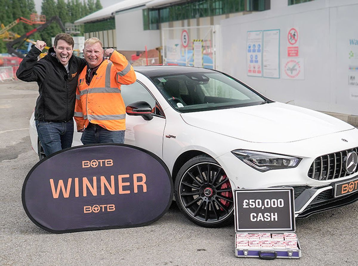 Nick Harper, right, has won a Mercedes and £50,000 cash