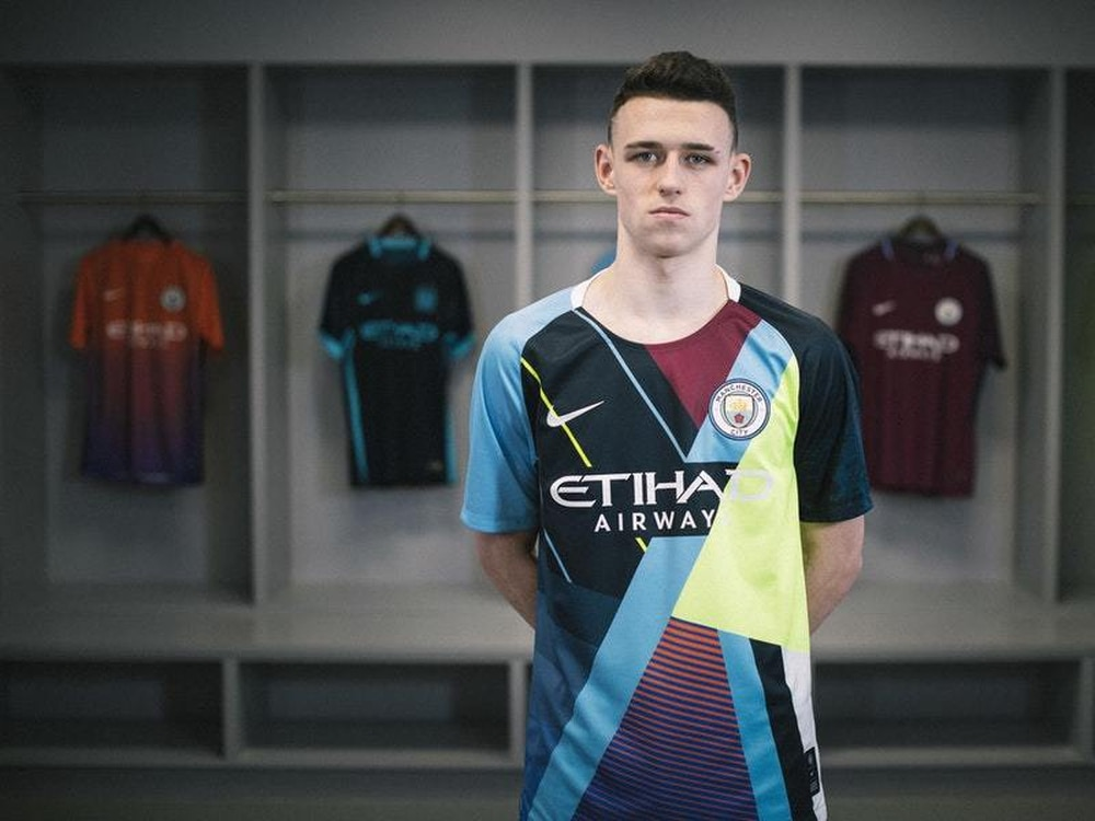 Manchester City midfielder Phil Foden models the club s new celebration  shirt 01c0acc0f