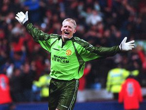 Manchester Utd v Arsenal FA Cup semi-final replay Villa Park 14.4.99  Penalty-save hero Peter Schmeichel joins in the celebrations follwing Ryan Giggs' winning goal in extra time.