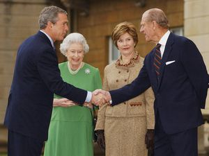 Then US president George Bush shakes hands with the Duke of Edinburgh in 2003