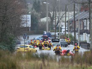 Rescue operations continue as emergency services take residents of Oxford Street, Nantgarw to safety (Ben Birchall/PA)