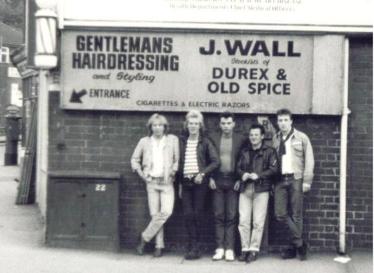 The Love Hounds pose for a picture outside the former Jack Wall barber's shop: Paul Aston (bass) Steve Cartwright (guitar) Eric Cox (guitar) Tim Johnson (drums) and Gary O'Dea (vocals / harmonica).
