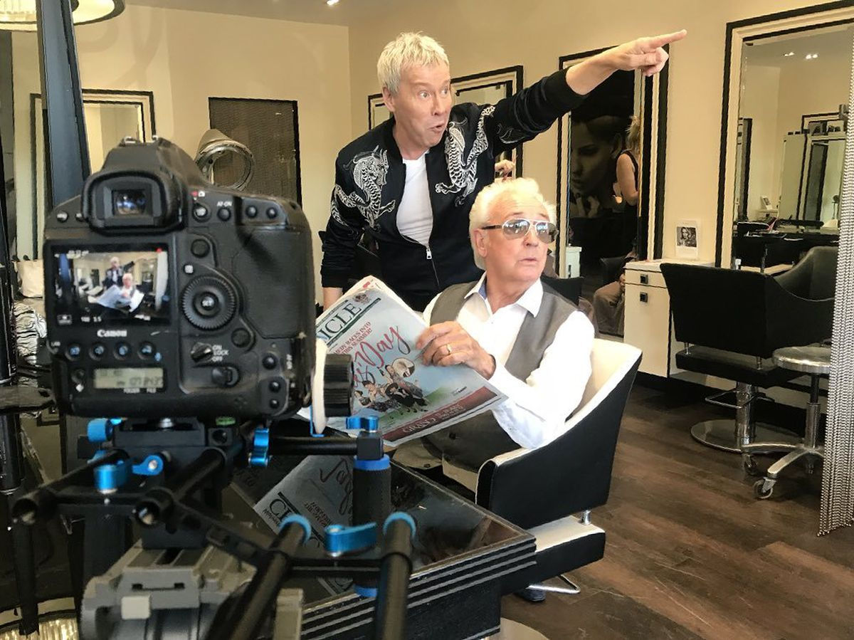 Short cut? Star Tony Christie gets directions from celebrity hairdresser Royston Blythe