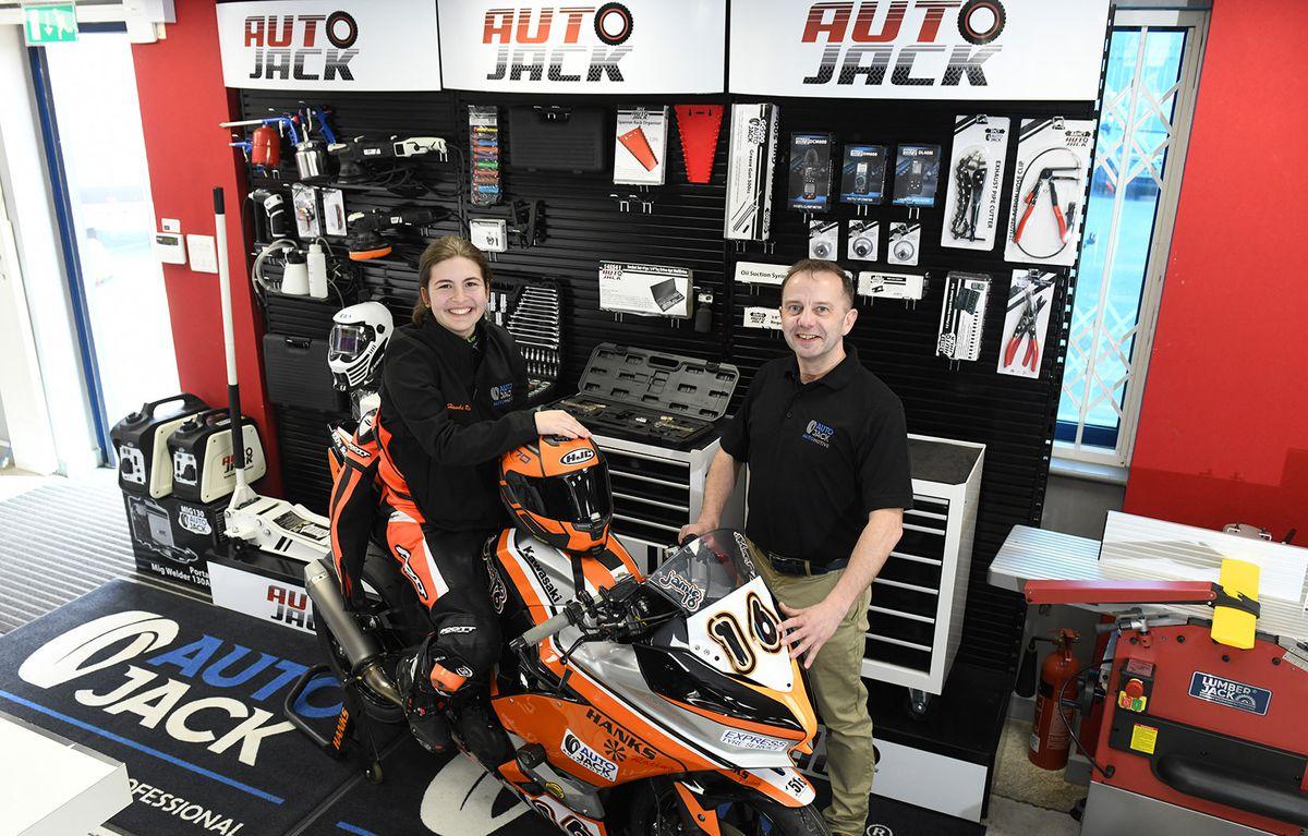 Jamie Hanks-Elliott and Fred Evans (AutoJack) celebrate the sponsorship deal