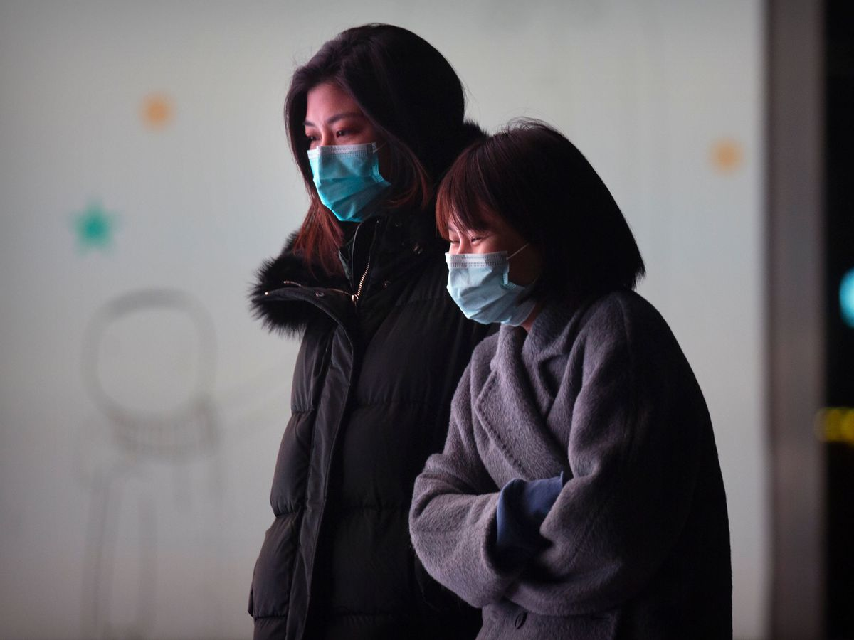 People wearing face masks to protect against the spread of the coronavirus in Beijing