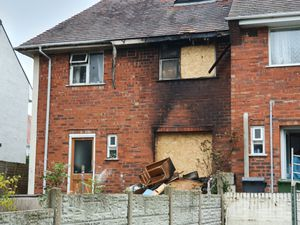 The back of the house has suffered the worst of the fire, with fire damage and windows boarded up