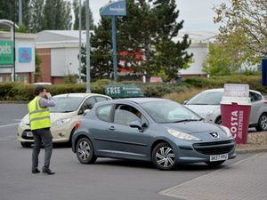 Drivers queue to fill up at Sainsbury's at the Reedswood Retail Park in Walsall