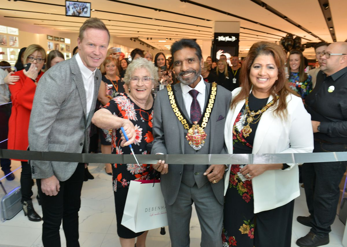 Ann Guest with the then Mayor of Wolverhampton, Councillor Elias Mattu, and Mayoress Asha Mattu and former Wolves star Jody Craddock as they officially open the brand new Debenhams store