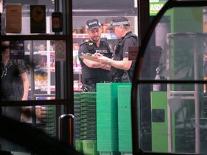 Police officers in Asda, Heath Town, after a man was stabbed. Photo: SnapperSK