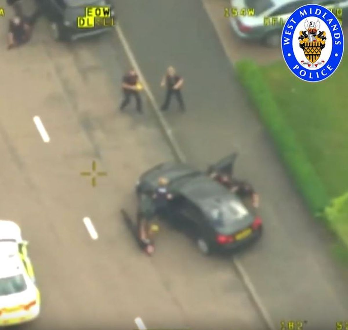 Aerial footage shows the unmarked car with Hussain at the wheel