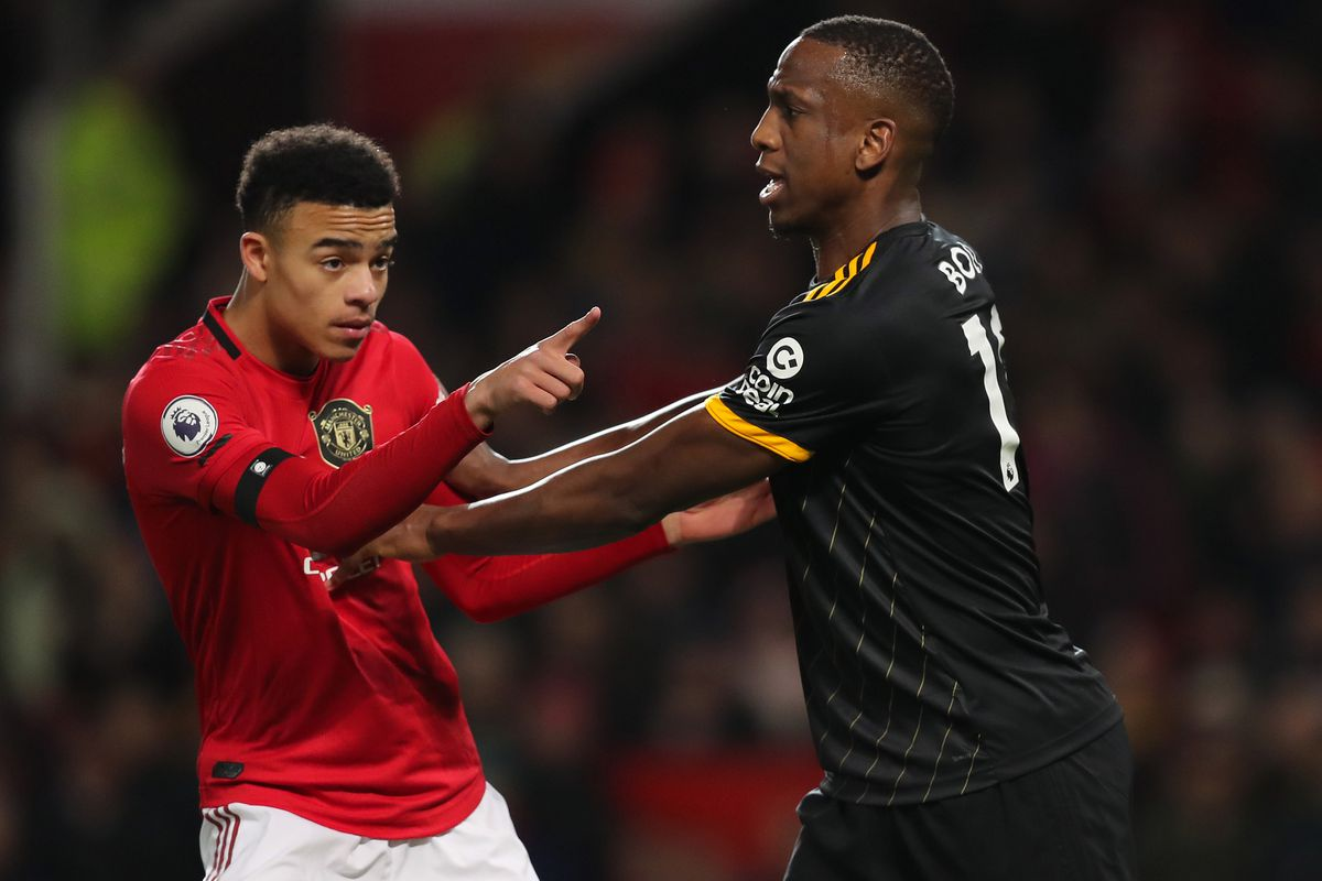 Mason Greenwood of Manchester United and Willy Boly of Wolverhampton Wanderers (AMA)