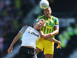 Jake Livermore leaps for the ball. (AMA)