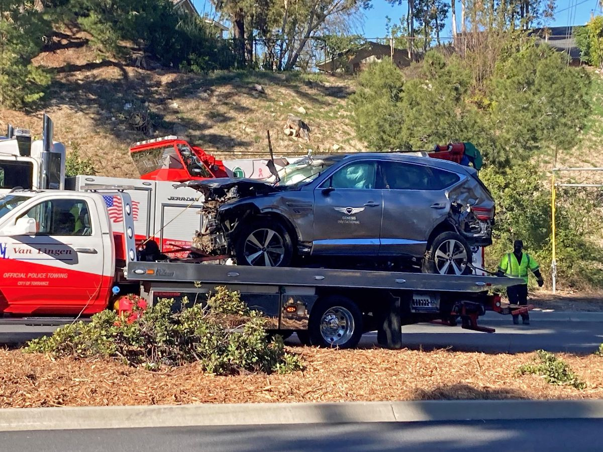 The vehicle driven by Tiger Woods on the back of a truck in Los Angeles after he suffered leg injuries when the vehicle rolled over