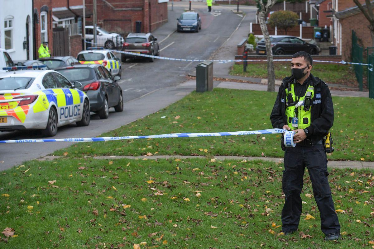 Police at the scene in Crossley Street, in Netherton. Photo: Snapper SK