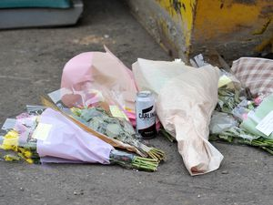 Floral tributes have been left at the scene of the industrial estate
