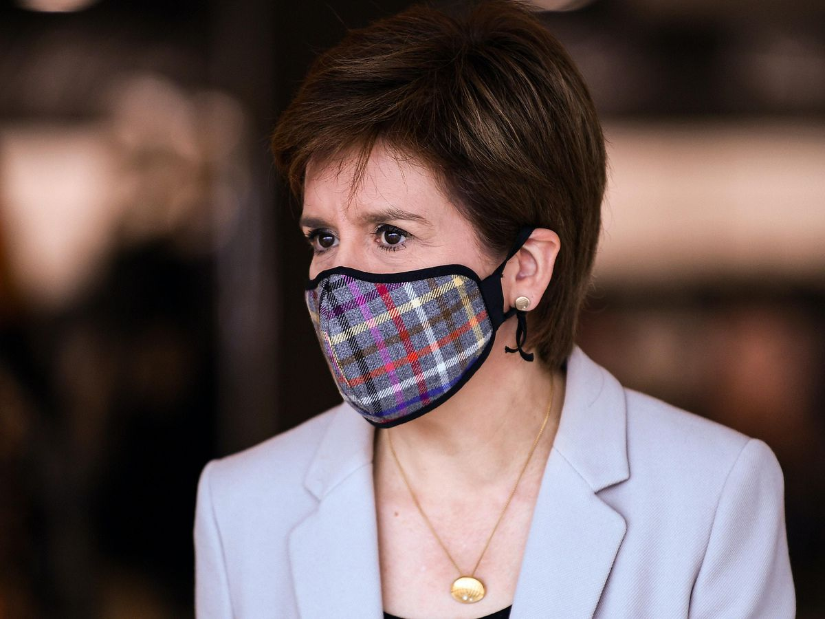 Nicola Sturgeon wearing a tartan face mask