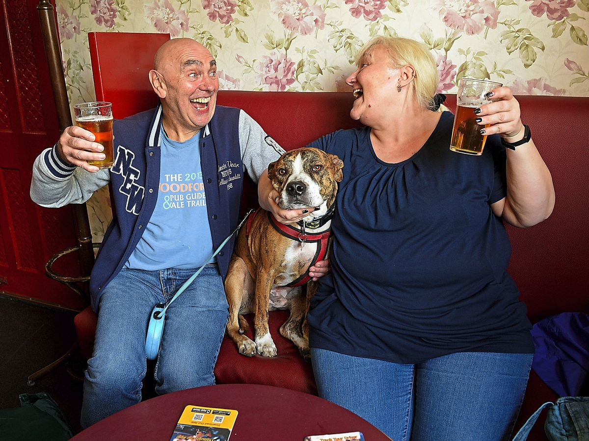 Roy and Sarah Adderley with Juke the dog, at The Swan, Netherton