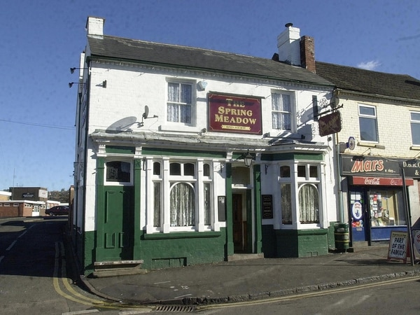 Woman taken to hospital after fire sparked above Black Country pub