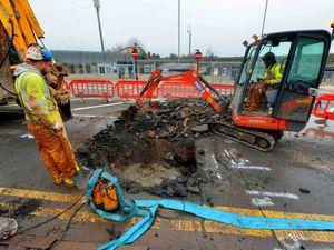 Workers repairing the burst main on Forge Lane in Cradley Heath
